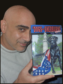 Author Tom MOdy holding his novel The Dogs of Sherburne